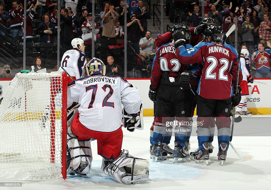 Members of the Colorado Avalanche celebrate a goal against the Columbus Blue Jackets at the Pepsi Center on January 24, 2013 in Denver, Colorado. Colorado beat Columbus 4-0.
