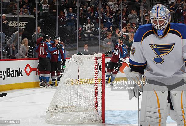 Members of the Colorado Avalanche celebrate a goal as goaltender Jake Allen looks on the St Louis Bluesas at the Pepsi Center on April 21 2013 in...