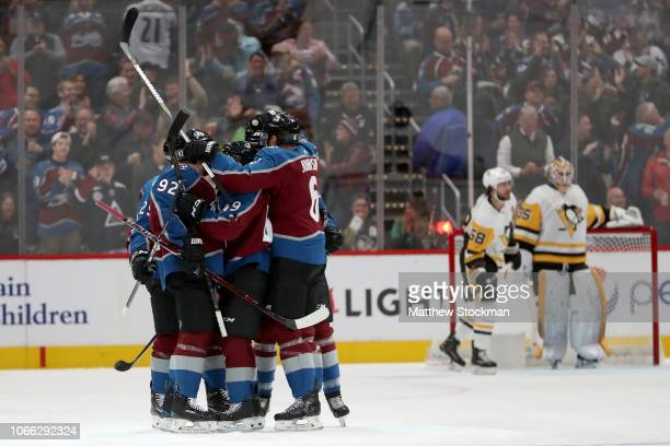 Members of the Colorado Avalanche celebrate a golal by Samuel Girard against the Pittsburgh Penguins in the first period at the Pepsi Center on...