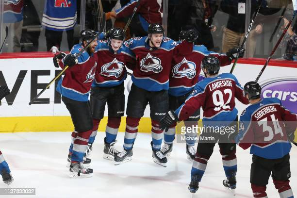 Members of the Colorado Avalanche celebrate with teammate Mikko Rantanen after his game winning goal against the Calgary Flames in Game Four of the...