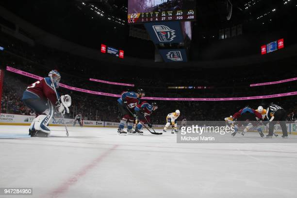 Members of the Colorado Avalanche faceoff against the Nashville Predators in Game Three of the Western Conference First Round during the 2018 NHL...