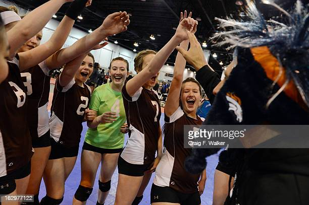 Members of the Colorado North Stars of Loveland celebrate their victory over Mountain West of Cache Valley UT during the Colorado Crossroads National...