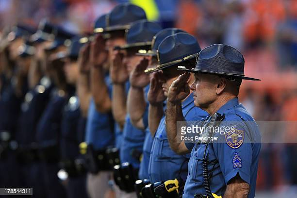 Members of the Colorado State Patrol during the National Anthem as the Denver Broncos prepare to host the Arizona Cardinals during preseason action...