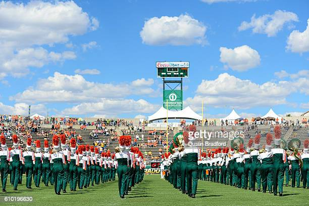 Members of the Colorado State Rams marching band march onto the field before a game between the Colorado State Rams and the Northern Colorado Bears...