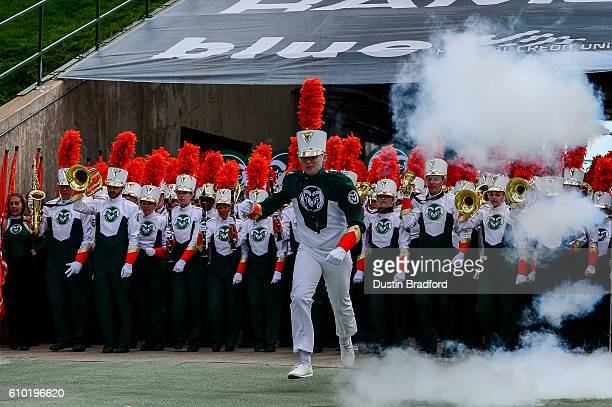 Members of the Colorado State Rams marching band run onto the field before a game between the Colorado State Rams and the Northern Colorado Bears at...