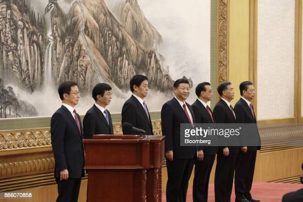 Members of the Communist Party of China's new Politburo Standing Committee Han Zheng from left Wang Huning Li Zhanshu Xi Jinping Li Keqiang Wang Yang...