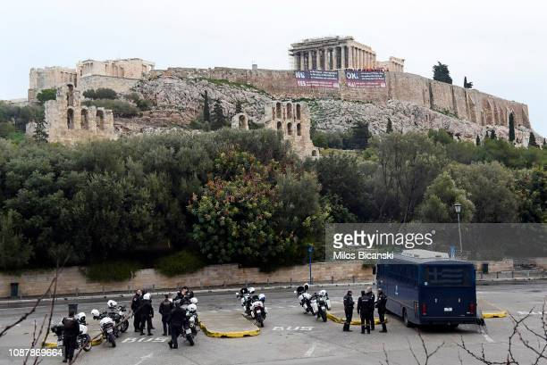 Members of the Communist Party of Greece hang larger banners protesting against the Prespa Agreement in front of the Parthenon temple on Acropolis...