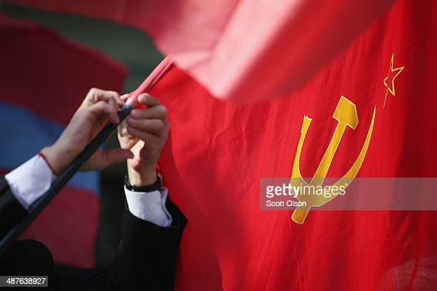 Members of the communist party prepare for a May Day march to Lenin Square on May 1 2014 in Donetsk Ukraine The march was the first of two marches...