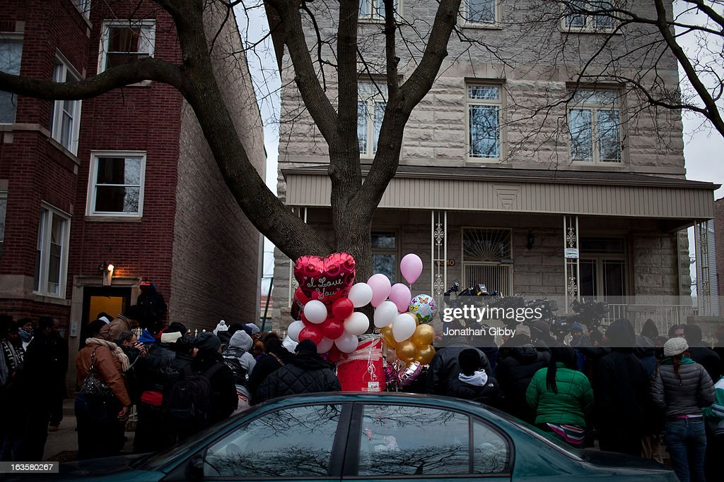 Members of the community and members of the media gather during a vigil for slain infant Jonylah Watkins on March 12, 2013 in Chicago, Illinois. The 6-month-old girl was shot five times on the 6500 block of South Maryland Avenue while her father was changing her diaper in the passenger seat of his car. The father, Jonathan Watkins remains is stable condition at Nothwestern Memorial Hospital after receiving three gunshot wounds.