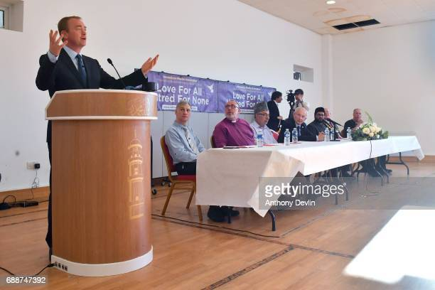 Members of the community and other faith leaders listen as Liberal Democrat Leader Tim Farron speaks during a Remembrance event held by the Ahmadiyya...