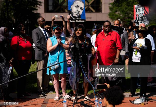 Members of the community group Families Supporting Families Against Police Violence speak during a press conference outside the Hennepin County...