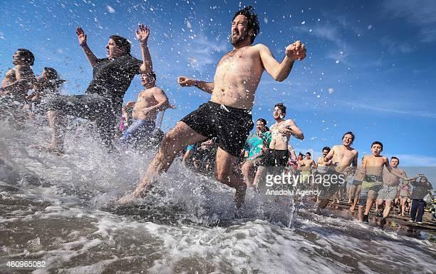 Members of the Coney Island's Polar Bear Club attend their annual New Year's Day Polar Bear Dip on New Years Day at Coney Island beach on in New York...