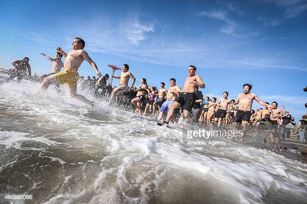 Members of the Coney Island's Polar Bear Club attend their annual 'New Year's Day Polar Bear Dip' on New Years Day at Coney Island beach on in New...