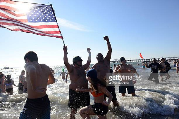 Members of the Coney Island's Polar Bear Club take an icy dip on New Years Day just off the Boardwalk of Coney Island January 1 2015 in the Brooklyn...