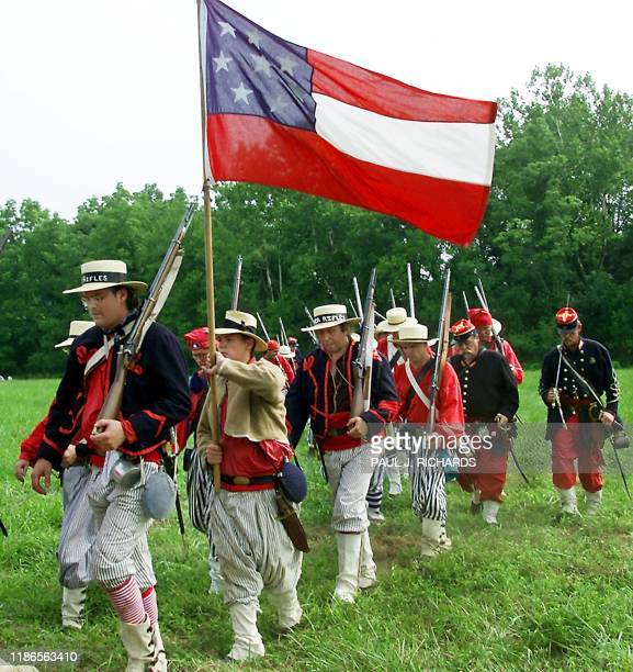 Members of the Confederate Army 1st Louisiana Tiger Rifles march under an early Confederate battle flag during the First Manassas Civil War...
