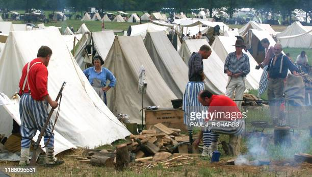 Members of the Confederate Army's 1st Louisiana Tiger Rifles make camp during the First Manassas Civil War Reenactment 03 August 2001 in Leesburg VA...
