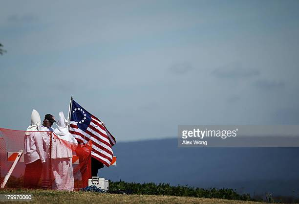Members of the Confederate White Knights hold a flag during a rally at the Antietam National Battlefield September 7 2013 near Sharpsburg Maryland...