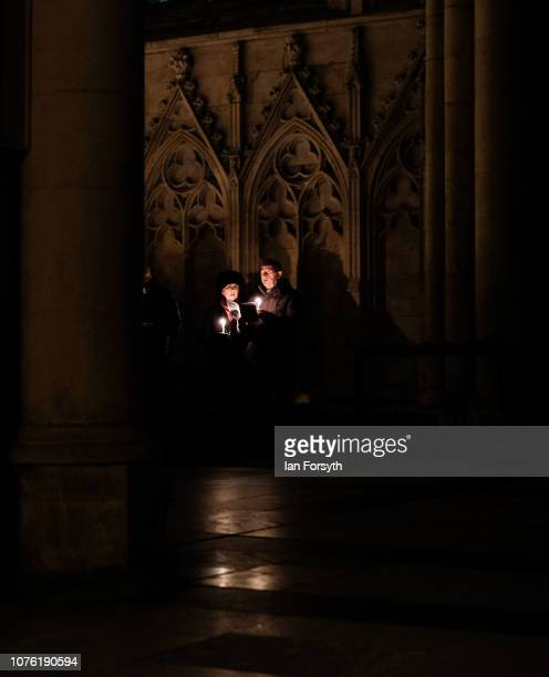 Members of the congregation hold candles and listen to the service during the Advent Procession at York Minster on December 02 2018 in York England...