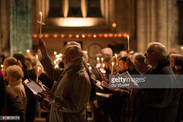Members of the congregation hold lit candles as they attend the Candlemas Festal Eucharist service at Ripon Cathedral in Ripon northern England on...