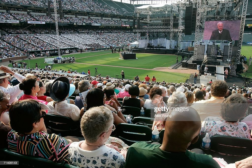 Members of the congregation listen to the preaching by evangelist Billy Graham during the Metro Maryland 2006 Festival July 9, 2006 at Oriole Park at Camden Yards in Baltimore, Maryland. Franklin Graham, son of Billy Graham, led the three-day-program filled with music, prayers and gospel messages.
