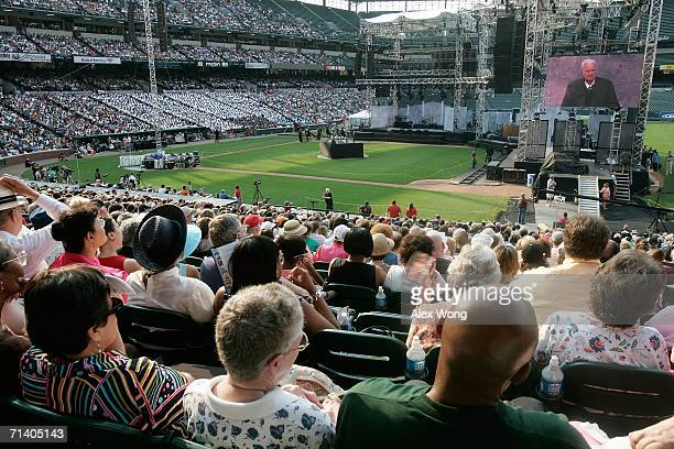Members of the congregation listen to the preaching by evangelist Billy Graham during the Metro Maryland 2006 Festival July 9 2006 at Oriole Park at...