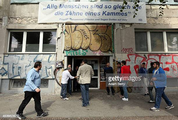 Members of the congregation of the Mevlana Mosque arrive for prayer on August 22 2014 in Berlin Germany Police continue to investigate the cause of a...