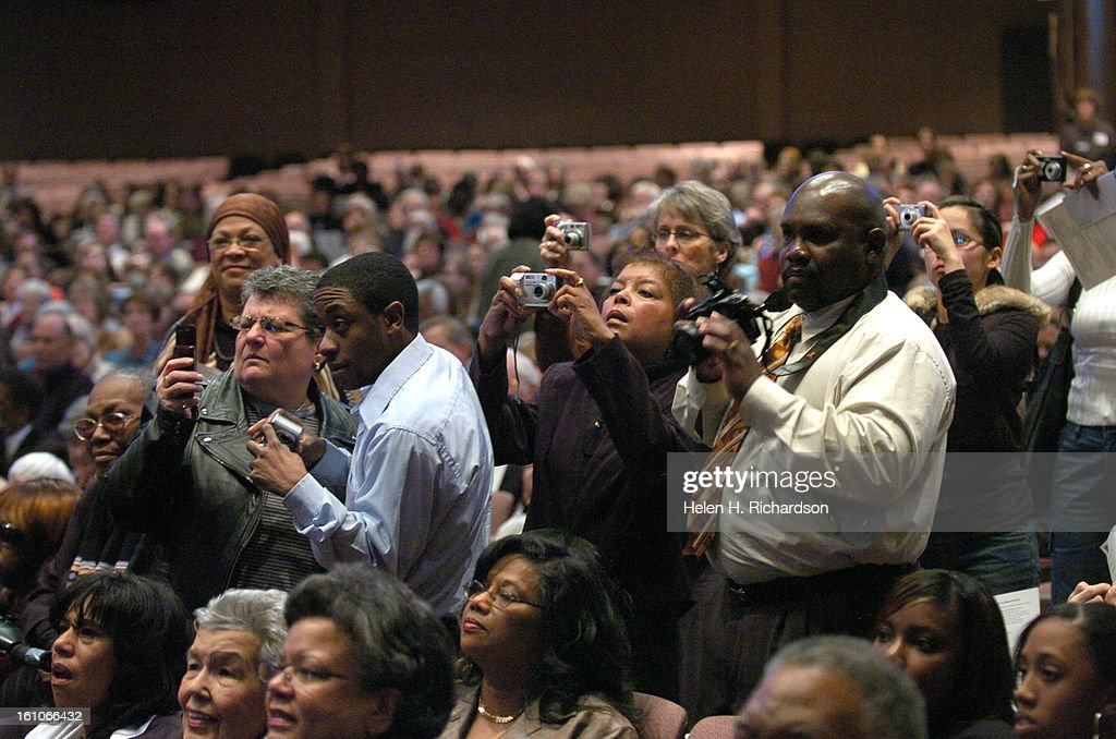 (HR) ABOVE: Members of the congregation quickly take photos of the members before the interfaith service began. The nine members of what is now called the Little Rock Nine came together for only the 5th time in 50 years at Congregation Emanuel for an inte : News Photo