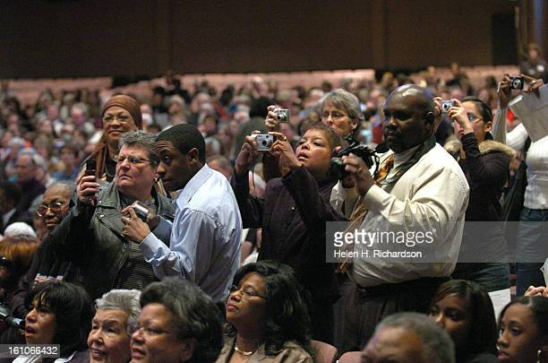 Members of the congregation quickly take photos of the members before the interfaith service began The nine members of what is now called the Little...