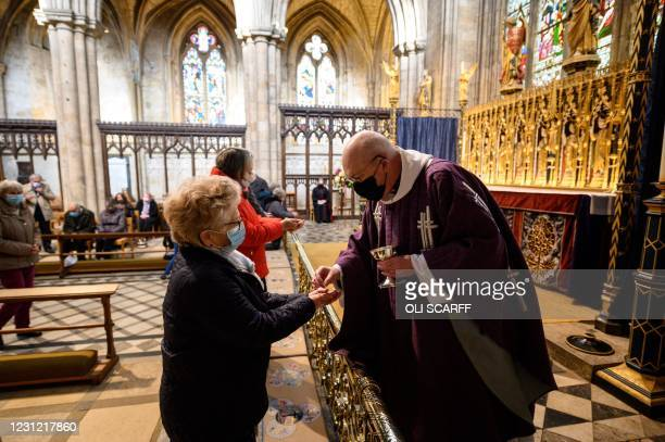 Members of the congregation receive communion from Canon Barry Pyke during a service in the quire of Ripon Cathedral on Ash Wednesday, the first day...