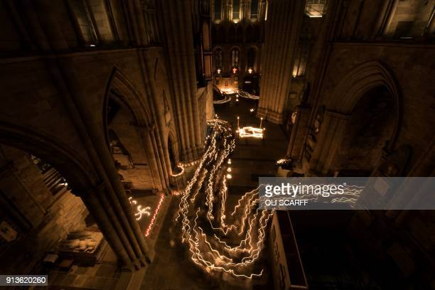 TOPSHOT Members of the congregation take part in a candlelit procession as they attend the Candlemas Festal Eucharist service at Ripon Cathedral in...