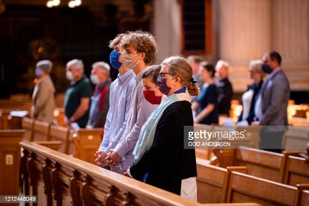 Members of the congregation wearing protective face masks observe social distancing as they attend a Sunday service at the Berliner Dom cathedral in...