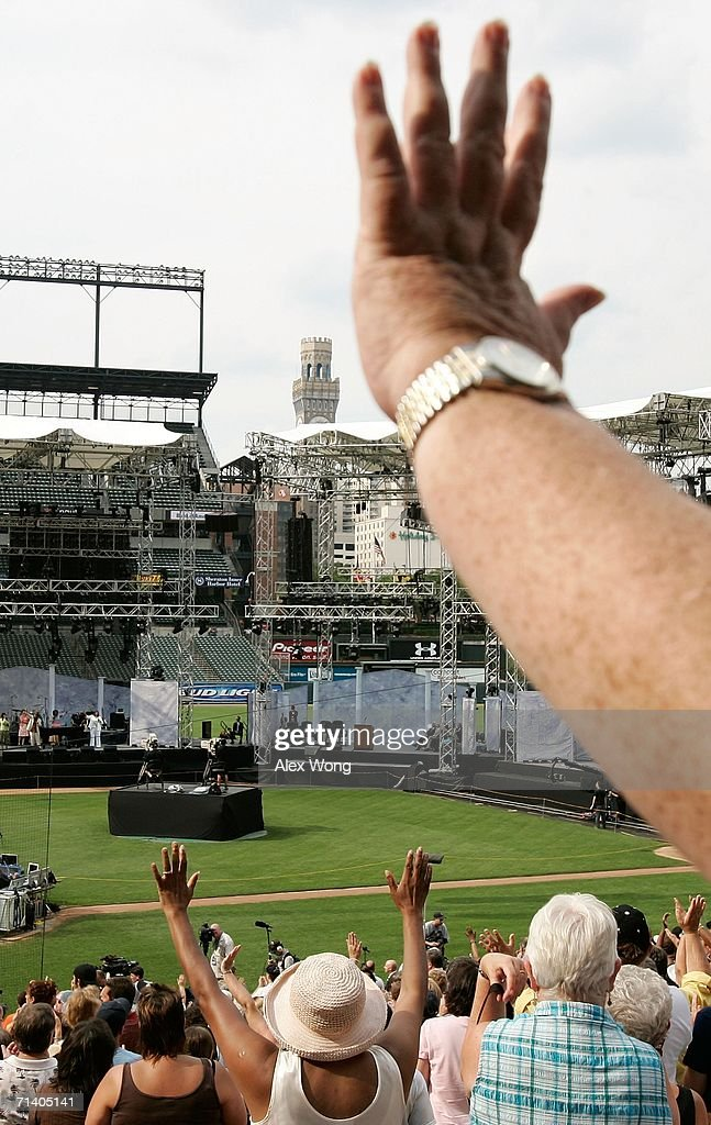 Members of the congregation worship as they take part during the Metro Maryland 2006 Festival July 9, 2006 at Oriole Park at Camden Yards in Baltimore, Maryland. Franklin Graham, son of evangelist Billy Graham, led the three-day-program filled with music, prayers and gospel messages.