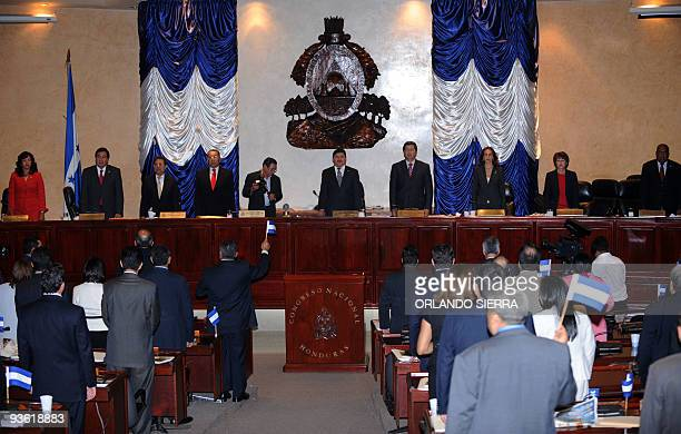 Members of the Congress of the Republic sing the national anthem after rejecting the reinstatement of ousted President Manuel Zelaya on December 2...