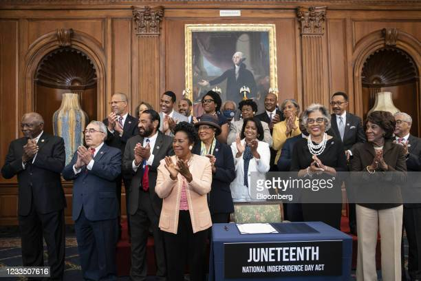 Members of the Congressional Black Caucus applaud as U.S. House Speaker Nancy Pelosi, a Democrat from California, not pictured, speaks during a bill...