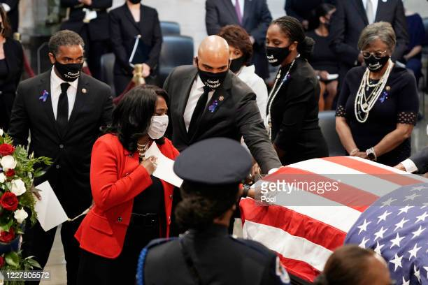 Members of the Congressional Black Caucus depart at the conclusion of a memorial ceremony for former Rep John Lewis in the Capitol Rotunda on July 27...