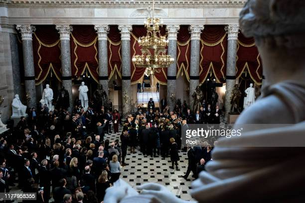 Members of the Congressional Black Caucus gather around the casket during a memorial service for U.S. Rep. Elijah Cummings in the Statuary Hall of...