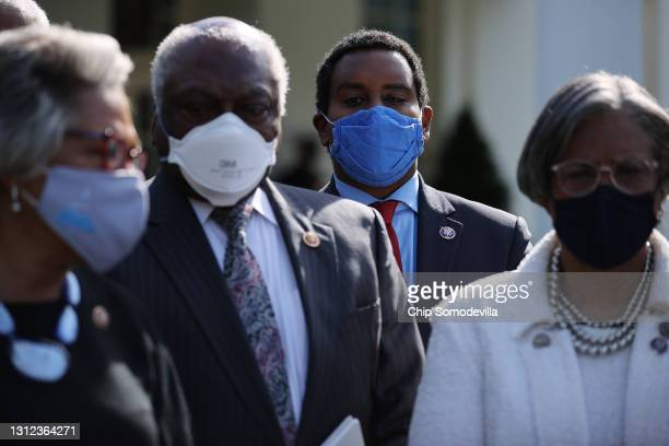 Members of the Congressional Black Caucus, including Rep. Joe Neguse , talk to reporters following a meeting with U.S. President Joe Biden and Vice...