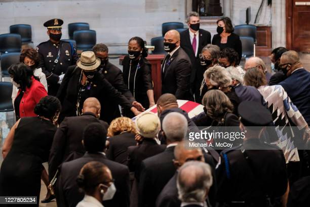 Members of the Congressional Black Caucus pay their respects as the Rep John Lewis lies in state at the US Capitol Rotunda in Washington DC on July...