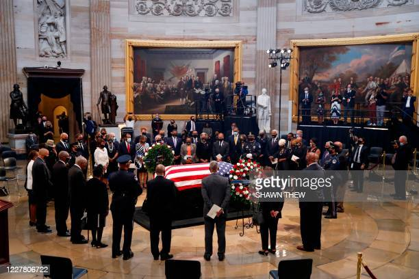 Members of the Congressional Black Caucus pay their respects to US Representative from Georgia John Lewis following a memorial service in the Rotunda...