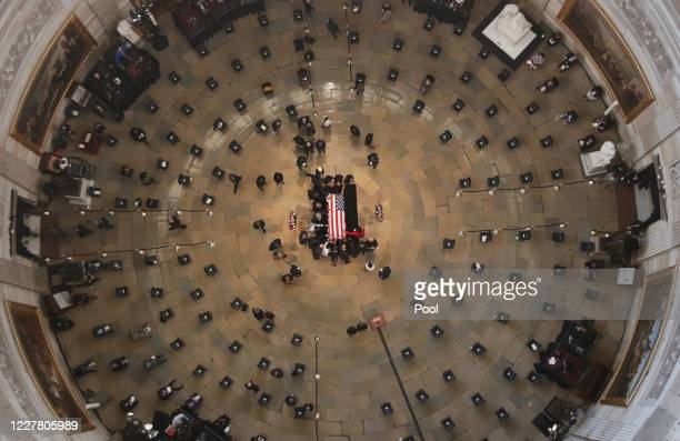 Members of the Congressional Black Caucus reach in and touch the casket of civil rights pioneer and longtime US Representative John Lewis who died...