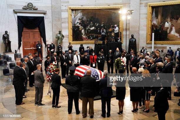 Members of the Congressional Black Caucus say farewell at the conclusion of memorial ceremony for former Rep John Lewis in the Capitol Rotunda on...