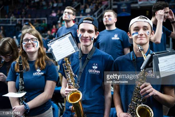 Members of the Connecticut Huskies band pose for a photo prior to the first half of the game between the Connecticut Huskies and the Louisville...