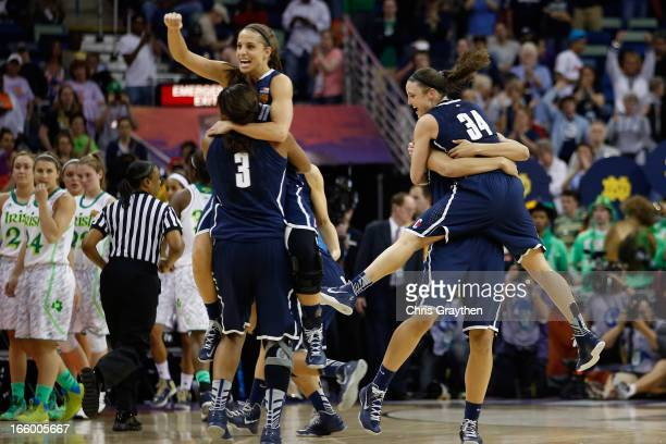 Members of the Connecticut Huskies celebrate after defeating the Notre Dame Fighting Irish 8365 during the National Semifinal game of the 2013 NCAA...