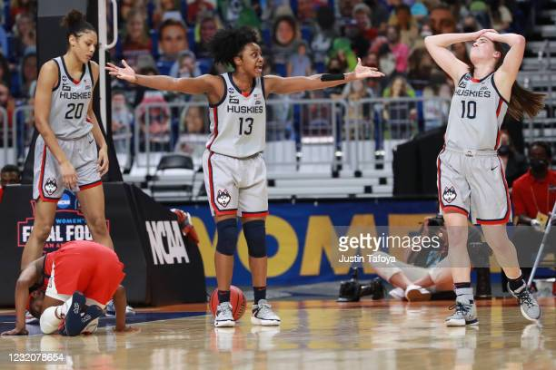 Members of the Connecticut Huskies react during the second half against the Arizona Wildcats during the semifinals of the NCAA Women's Basketball...