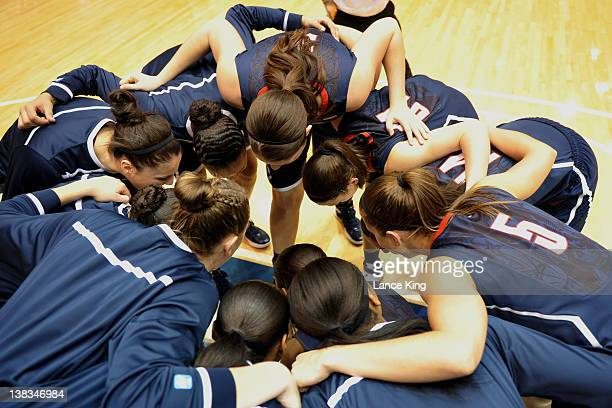 Members of the Connecticut Huskies team huddle prior to a game against the Duke Blue Devils at Cameron Indoor Stadium on January 30 2012 in Durham...