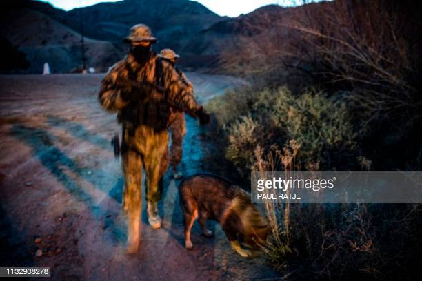Members of the Constitutional Patriots New Mexico Border Ops Team militia Viper and Stinger who go by aliases to protect their identity patrol the...