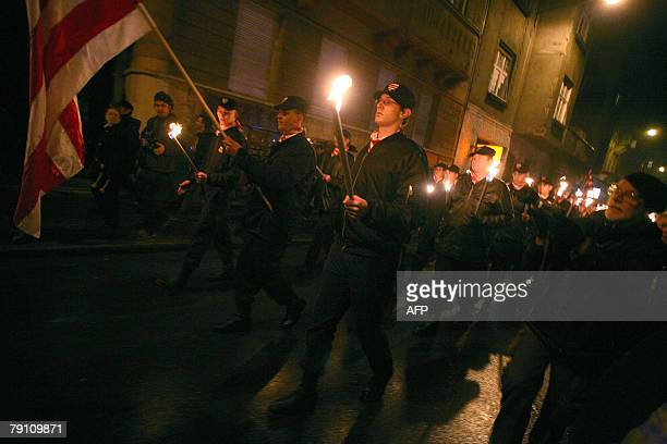 Members of the controversial extremeright 'Magyar Garda' or Hungarian Guard protest against the urban Gypsy community in downtown Budapest 18 January...