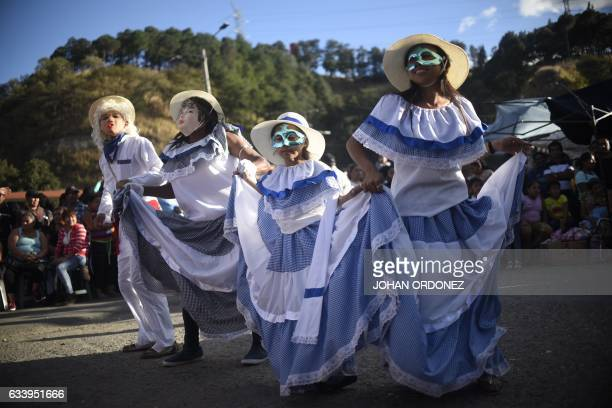 TOPSHOT Members of the 'Convite de fieros de San Jose' traditional dance group take part in the celebrations of the Virgin of Candelaria in Villa...
