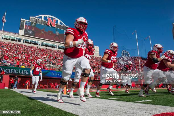 Members of the Corn Husker Football team take the field after halftime during the game between the BethuneCookman Wildcats and the Nebraska...
