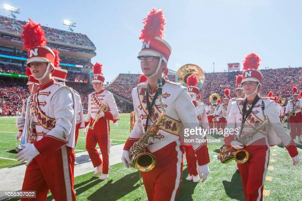 Members of the Corn Husker Marching Band walk to their position on the sidelines during the game between the BethuneCookman Wildcats and the Nebraska...